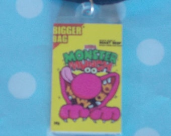 Monster Munch Pendant On Black Cord Necklace