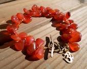 Carnelian Bracelet and Gold Bronze, Flat Teardrop Carnelian Bracelet, Dark Orange Carnelian Bracelet, Om Symbol, Artisan Jewelry