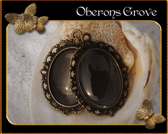 2 filigree settings bronze with 25x18mm cabochons