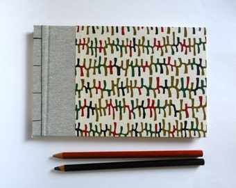 Little Golden book or travelogue, Japanese bookbinding and paper katazome, white pages.