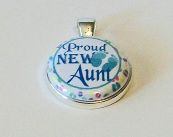 Blue and White Proud New Aunt Round Silver Pendant Charm