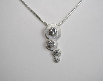 Graduated cz bubbles sterling silver pendant