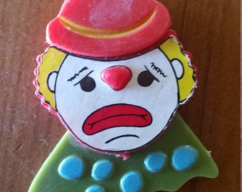 Vintage plastic sad clown magnet
