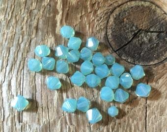 Swarovski Bi Cone Beads - Opaque Pacific Opal - 6mm - 06 Beads