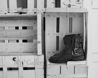 Black boots in old crates, black and white photograph, art