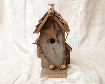 Rustic Birdhouse made from old reclaimed barn lumber.