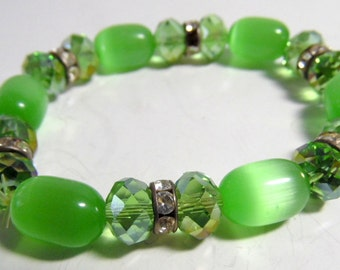Spring green transluscent beads, faceted rainbow beads, spacers with crystals.  Catches the light beautifully.  Stretchy