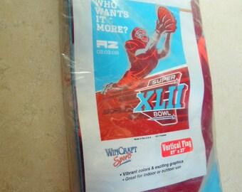 "Super Bowl XLII NFL Football,   Who wants it More?  Vertical flag.  MIP. 27x37"""