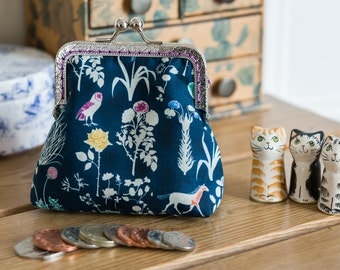 Coin purse made with Liberty Tana Lawn in the print: 'Yoshie', with a navy cotton lining, and hand stitched silver metal frame