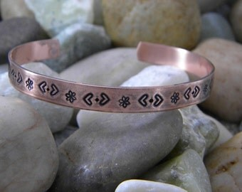 Copper hand stamped bracelet - Hearts and Daisies
