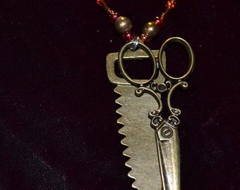 saw and scissor necklace