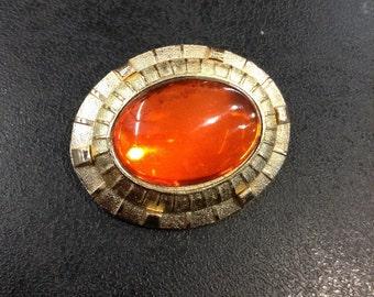 Orange stone brooch