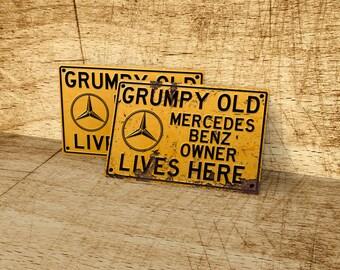 Grumpy old Mercedes Benz owner lives here metal sign.