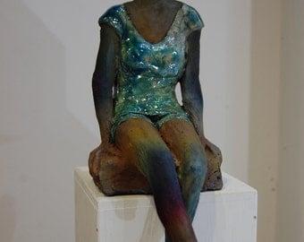 Sitting girl - Orange glazed ceramic - 12x20x35cm