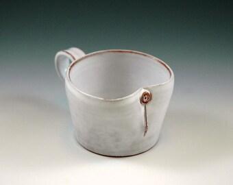 Small white mug for espresso, mulled wine or for children.