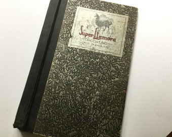 Unique vintage black silver textured legal size book Super Llamora  from England