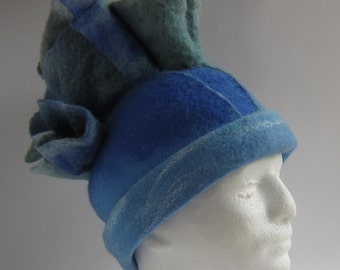 Structural and striking, blue folds, large, felted wool hat