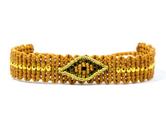 Caramel bracelet with evil eye