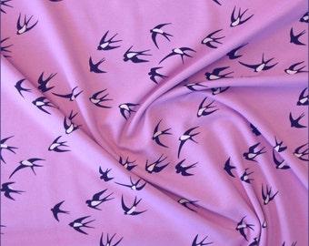 Jersey Fabric Swallows on Lilac 150cm, 95 percent Cotton 5 percent Elastane