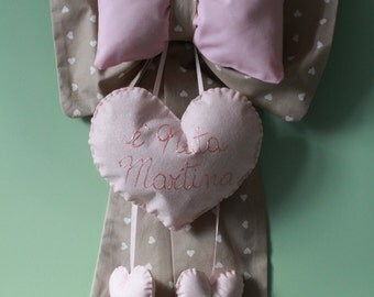 Upholstered in fabric and Ribbon with heart with birth name