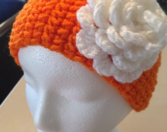 Orange head band with white flower