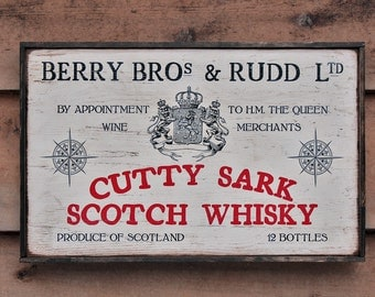 Rustic wooden sign 'Cutty Sark Scotch Whiskey'