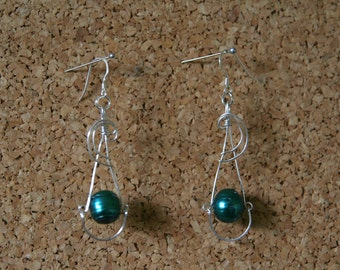 Earrings. Cultivated blue-green (chartreuse) potato pearl silver wire earrings, with 925 sterling silver ear wires. 59mm