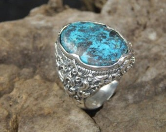 Silver ring motif patra bali with turquoise stone