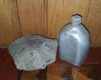 WWI US Army Canteen LF & C. 1918 date, with cap, chain and canvas cover.