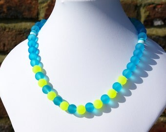 Bright turquoise and lime green necklace, using round frosted glass beads.  Simple but effective.