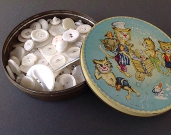 Vintage tin with vintage white buttons