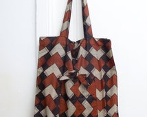 Shopping bag, grocery bag, reusable shopping bag or a tote bag, folding pouch, with graphic pattern of lozenges