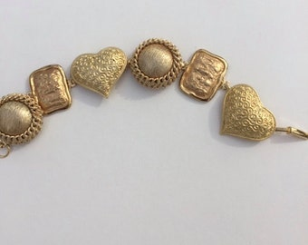 Gold tone bracelet for valentines day  made from vintage clip earrings