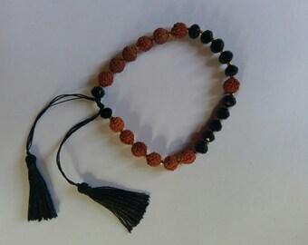 Handmade seed and crystal bead with tassle bracelet.