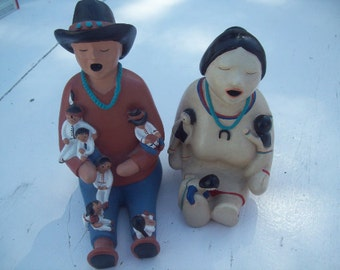 Signed Story Teller Figurines