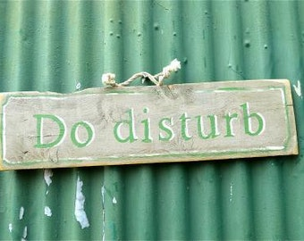 Fantastic distressed wooden do disturb wall sign