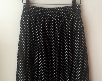 Vintage black pleated skirt with white polka dots XS