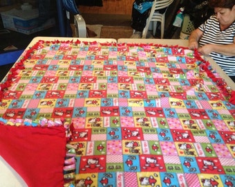 Patched Hello Kitty, double sided, hand tied, fleece blanket