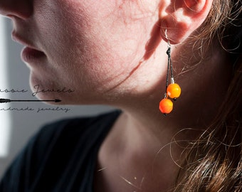 Sterling silver earrings with orange glass beads.