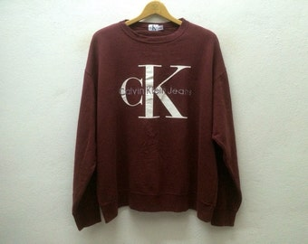 Vintage 90' CALVIN KLEIN JEANS cK Crewneck Embroidered Big Logo Burgundy Sweater Sz L Made in Canada