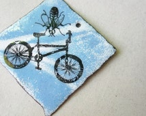 torch fired enameled recycled copper artisan component-bike and fly