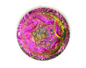 Hot pink reflecting green gold refracting Celtic shield 27mm Czech glass button. One button.