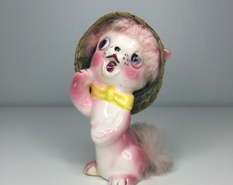 vintage ceramic cat figurine with fur and hat in basket