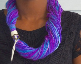 Yarn scarves with cute charms - purples and pastels