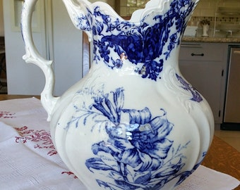 Large Flow Blue Pitcher in the Pattern called Lily made by S H & Sons