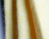 Yellow angora fabric tube...