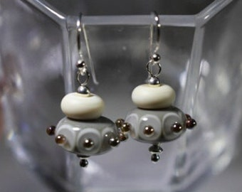 Grey and ivory lampwork beads with raise silver dots