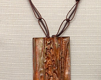 Copper pendant, forged handmade, foldforming, patina, waxed, dimensions cm 6,5 x 5 (in2.56x1.96)
