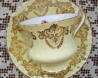 Paragon - Fine Bone China England - Vintage Tea Cup and Saucer - Yellow with Gold Filigree and Pink Roses Center, Scalloped and Ribbed