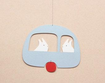 paper mobile, eddie rabbit caravan, blue sky and yellow